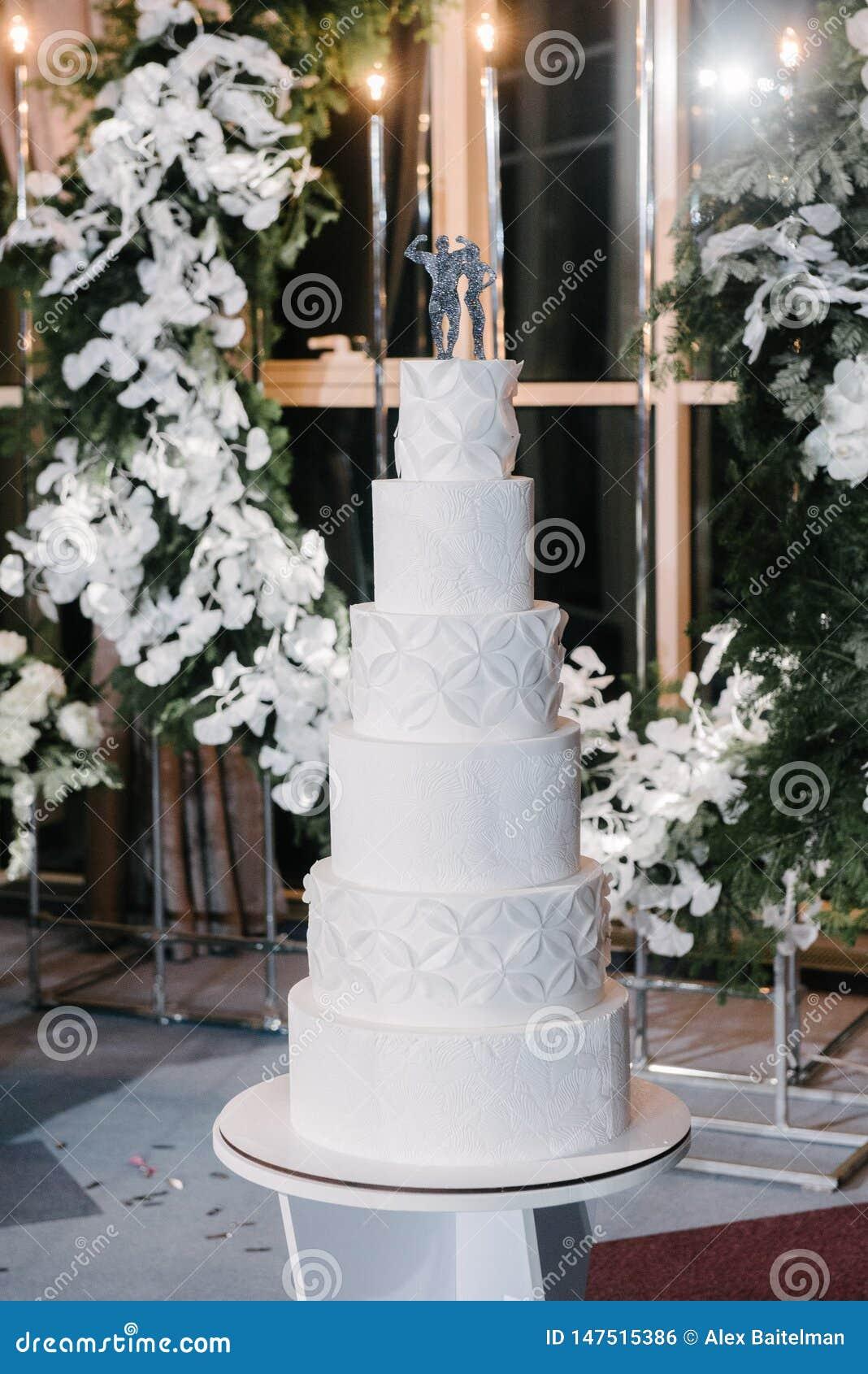 Castle Wedding Cake.Large White Wedding Cake With Castle Shaped Towers Stock Photo