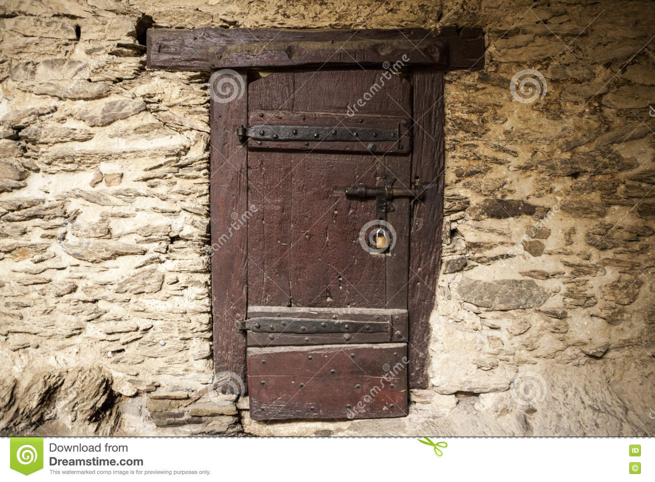 A large wooden door closed an old fortress in the stone for Door in the wall