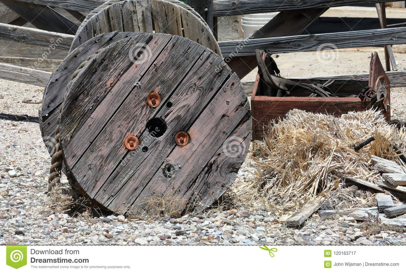 Large Wooden Spool With Heavy Rope And A Broken Toolbox On Front Of