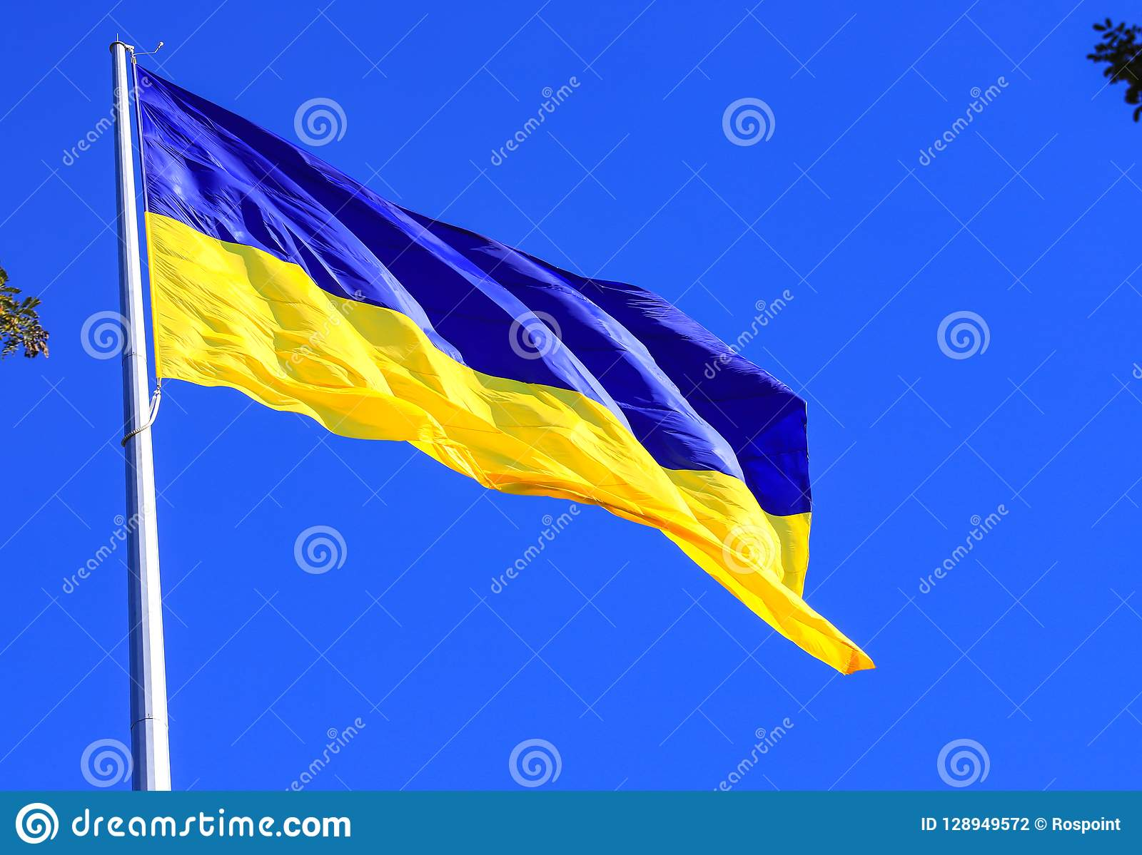 The largest yellow and blue state flag of Ukraine on the flagpole 30 meters in the Ukrainian Dnepr city