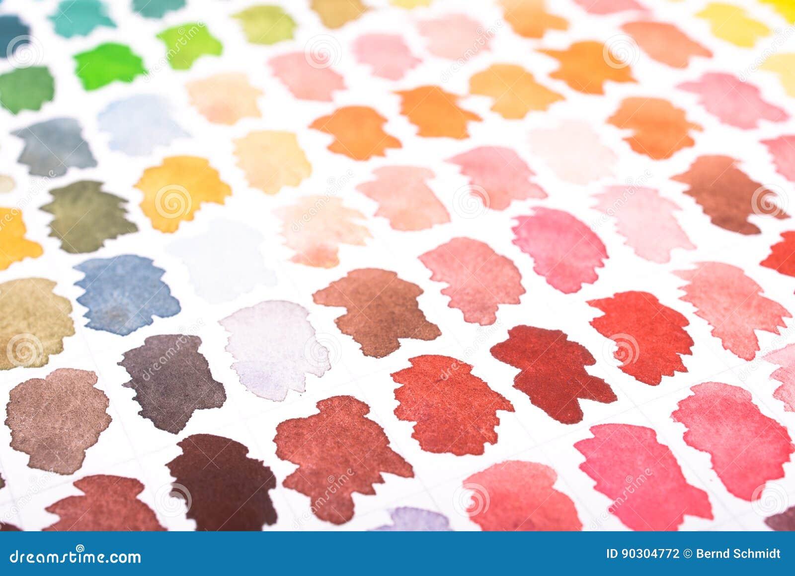 Las acuarelas en diversos colores broncean, rojo y verde