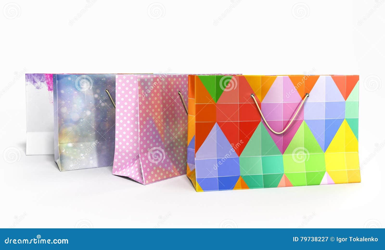 Las bolsas de papel 3d de Coloder rinden en el fondo blanco