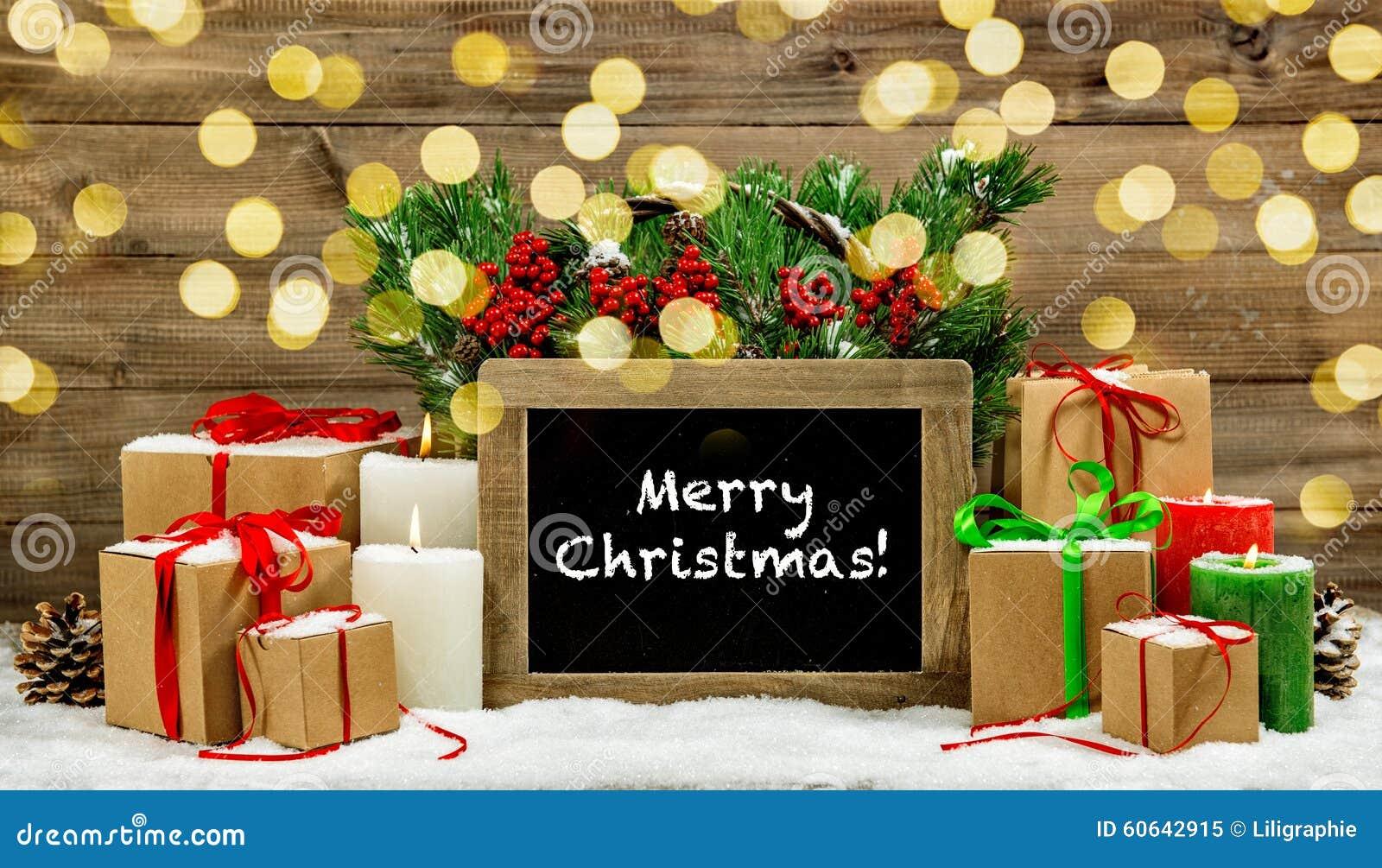 Las cajas de regalo ardientes de las velas de la decoración del vintage de la Navidad se encienden