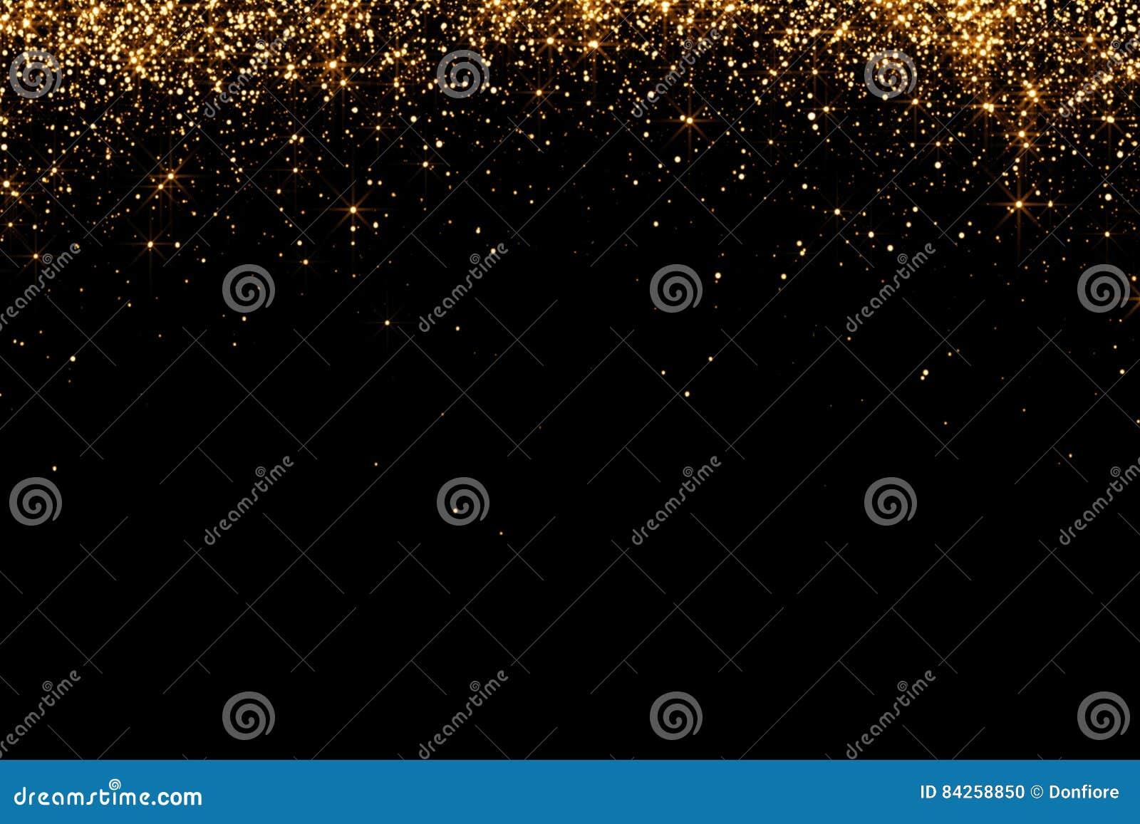 Las cascadas de las partículas de oro del champán de las burbujas de la chispa del brillo protagonizan en el fondo negro, día de