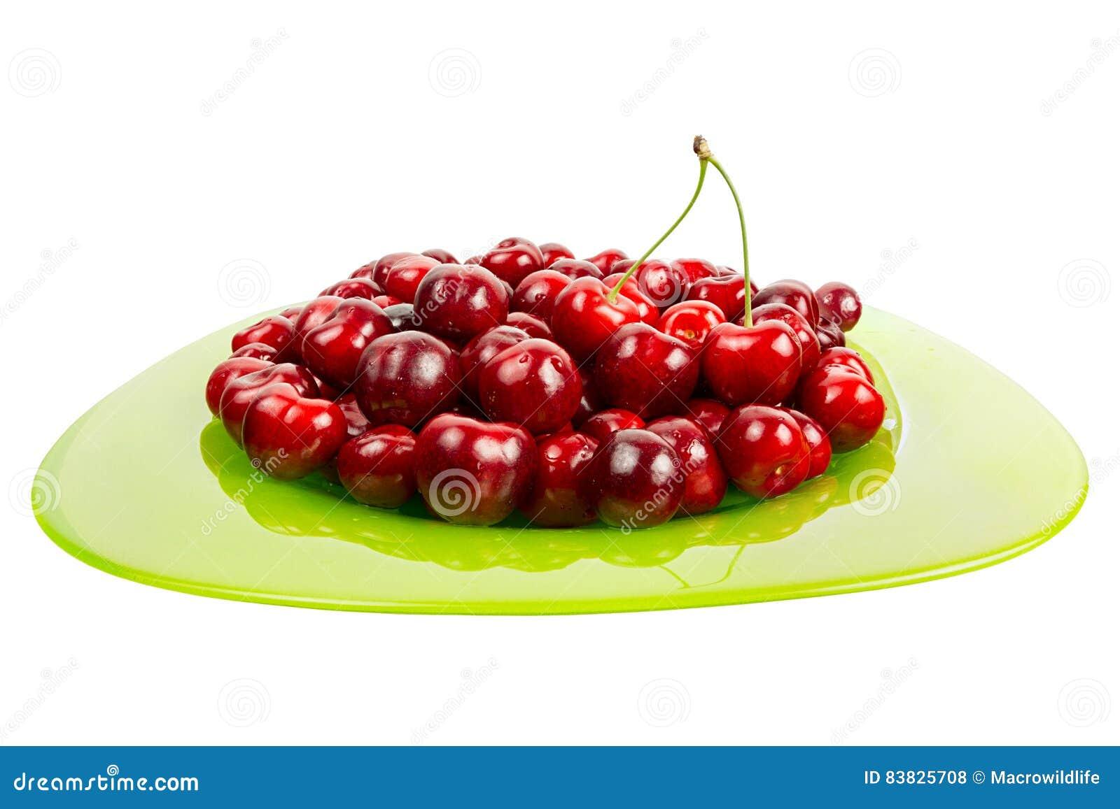 Las cerezas jugosas frescas dan fruto en un bol de vidrio - Bol de vidrio ...