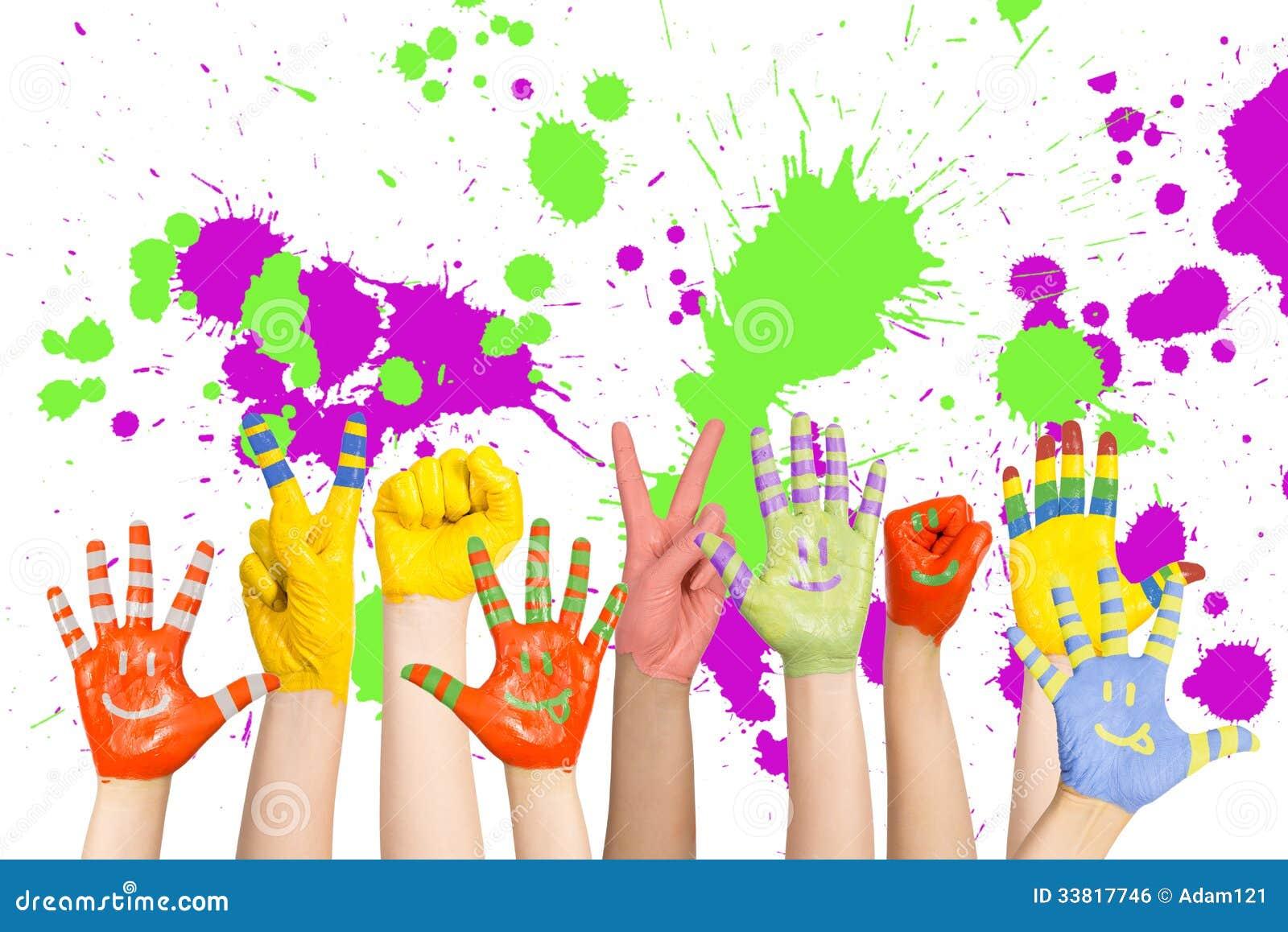 Las manos de los ni os pintados imagen de archivo libre de - Ninos pintando con las manos ...