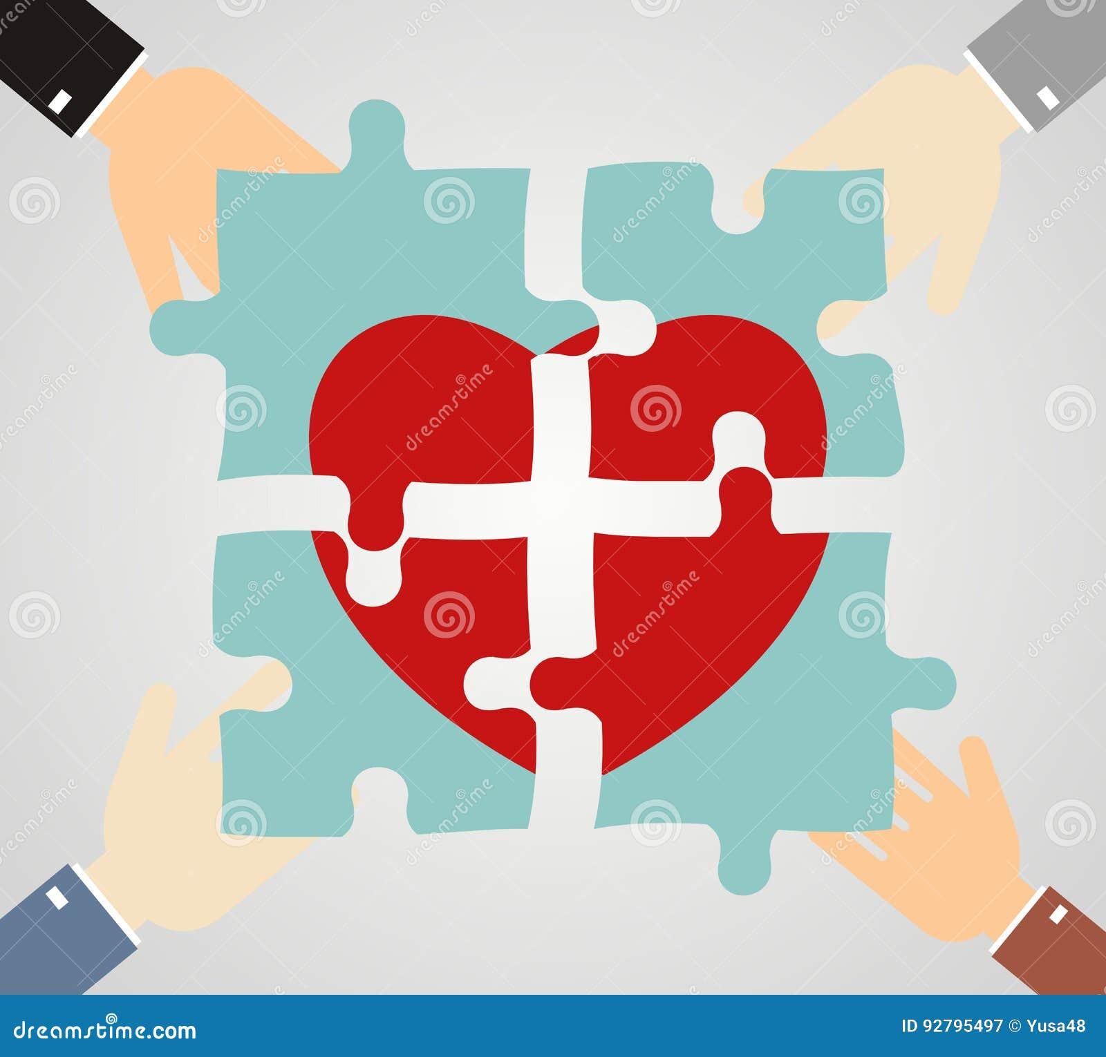 Las manos que ponen rompecabezas del corazón juntan Caridad, atención sanitaria