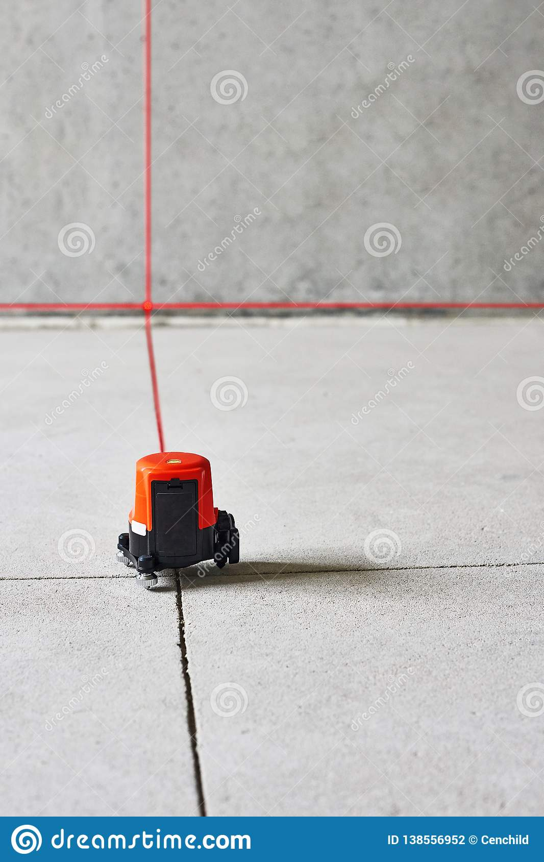 Laser Level Measuring Tool In Construction Site On The Floor In