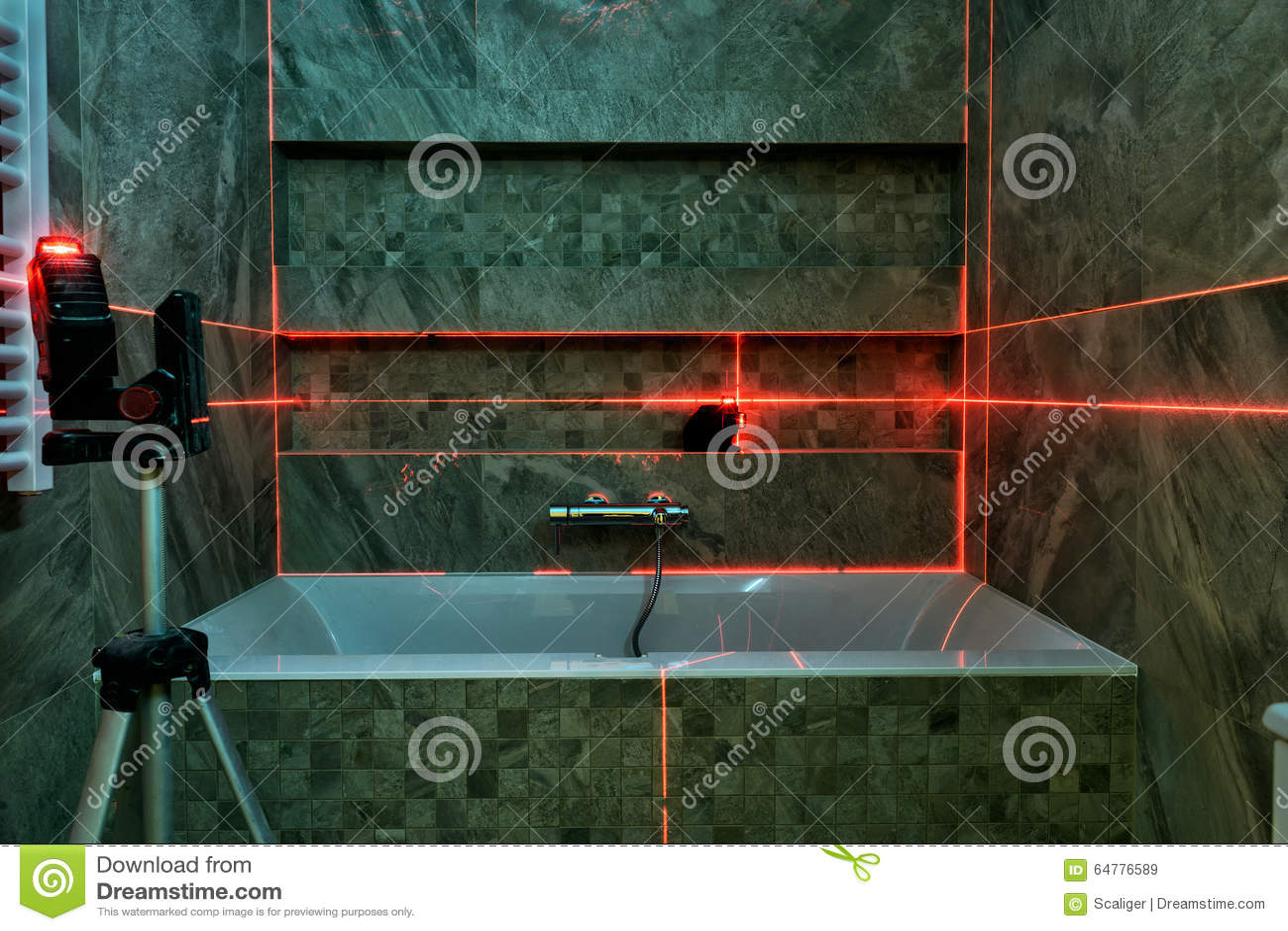 Laser measurement during bathroom renovation stock photo for Bathroom renovation tools