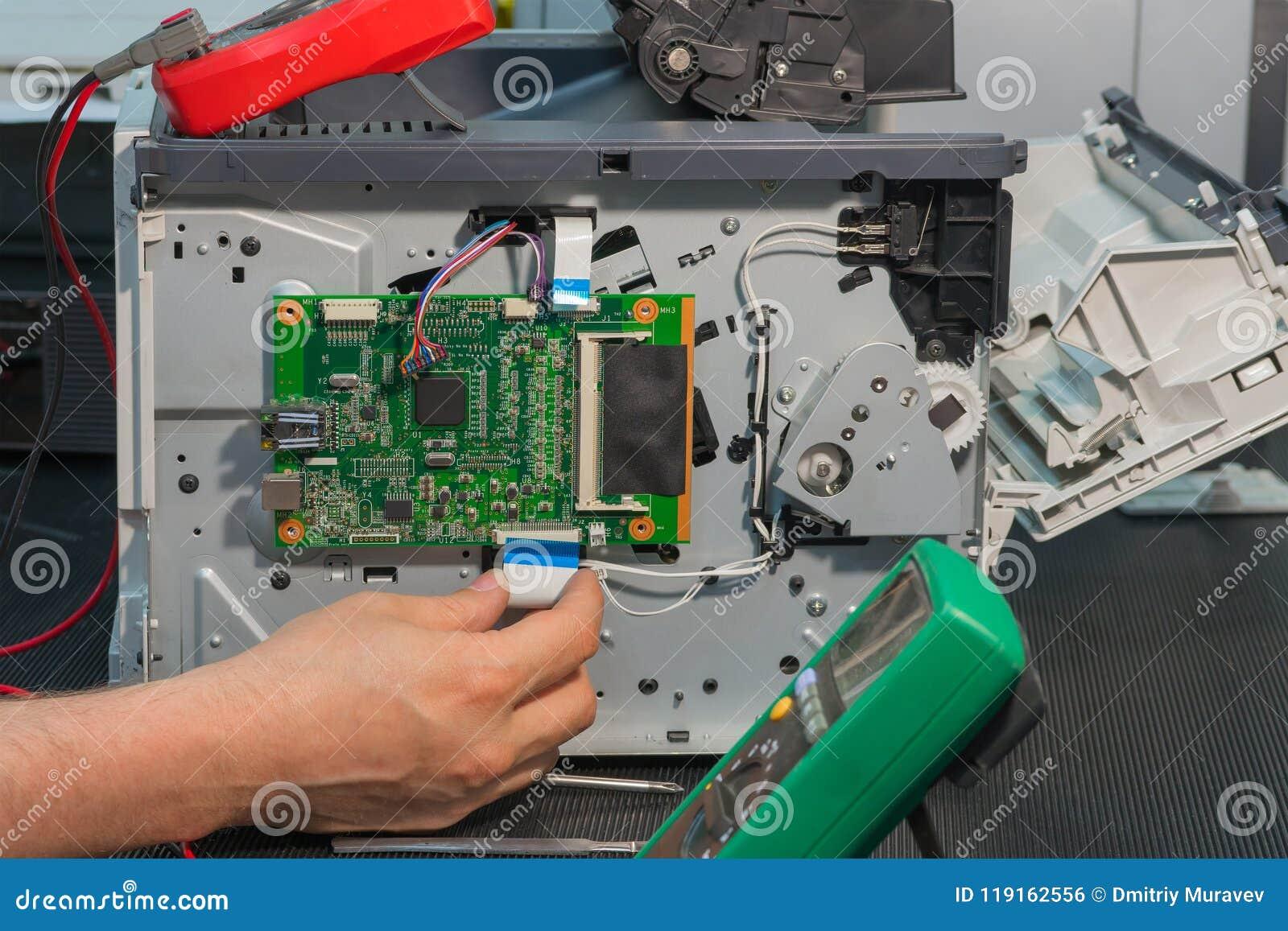 Printed Circuits Connection To Cable Not Lossing Wiring Diagram Printedcircuitboardassembliesjpg Laser Printer Repair Of The Ribbon Rh Dreamstime Com Broken Star Delta Circuit