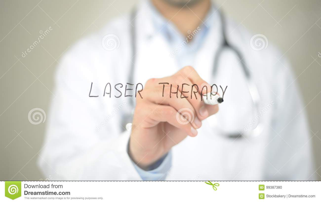 Laser Therapy , Doctor writing on transparent screen