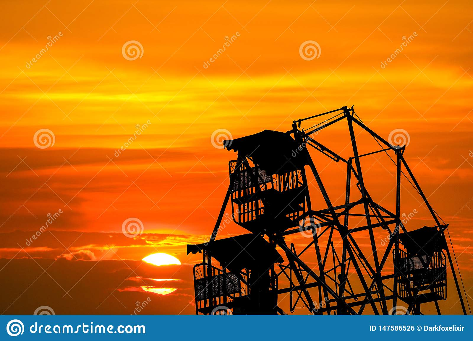 Last Light Of Sunset On Sky And Silhouette Ferris Wheel Stock Photo Image Of Outdoor Ride 147586526