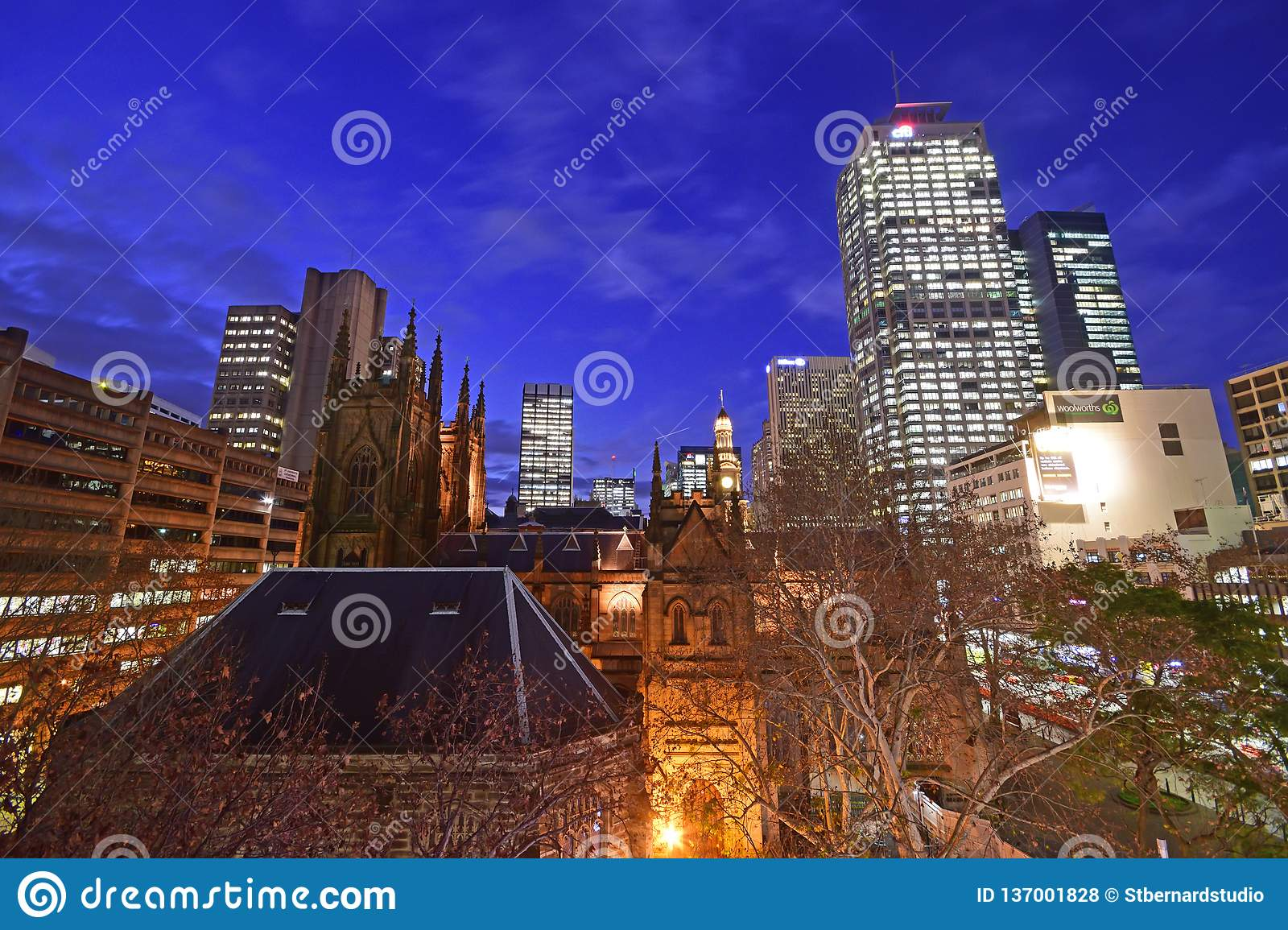 A late evening, early night scenery of glittering Sydney CBD around townhall area taken from rooftop building