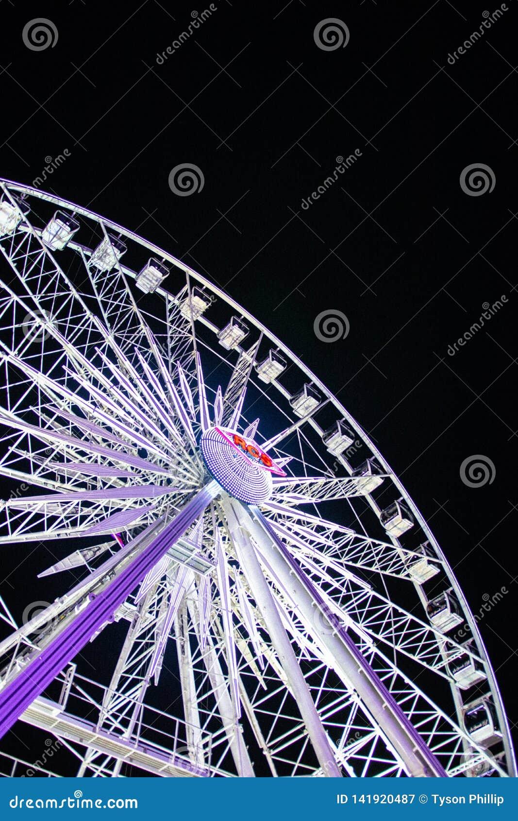 Late night carnival scene with ferris wheel