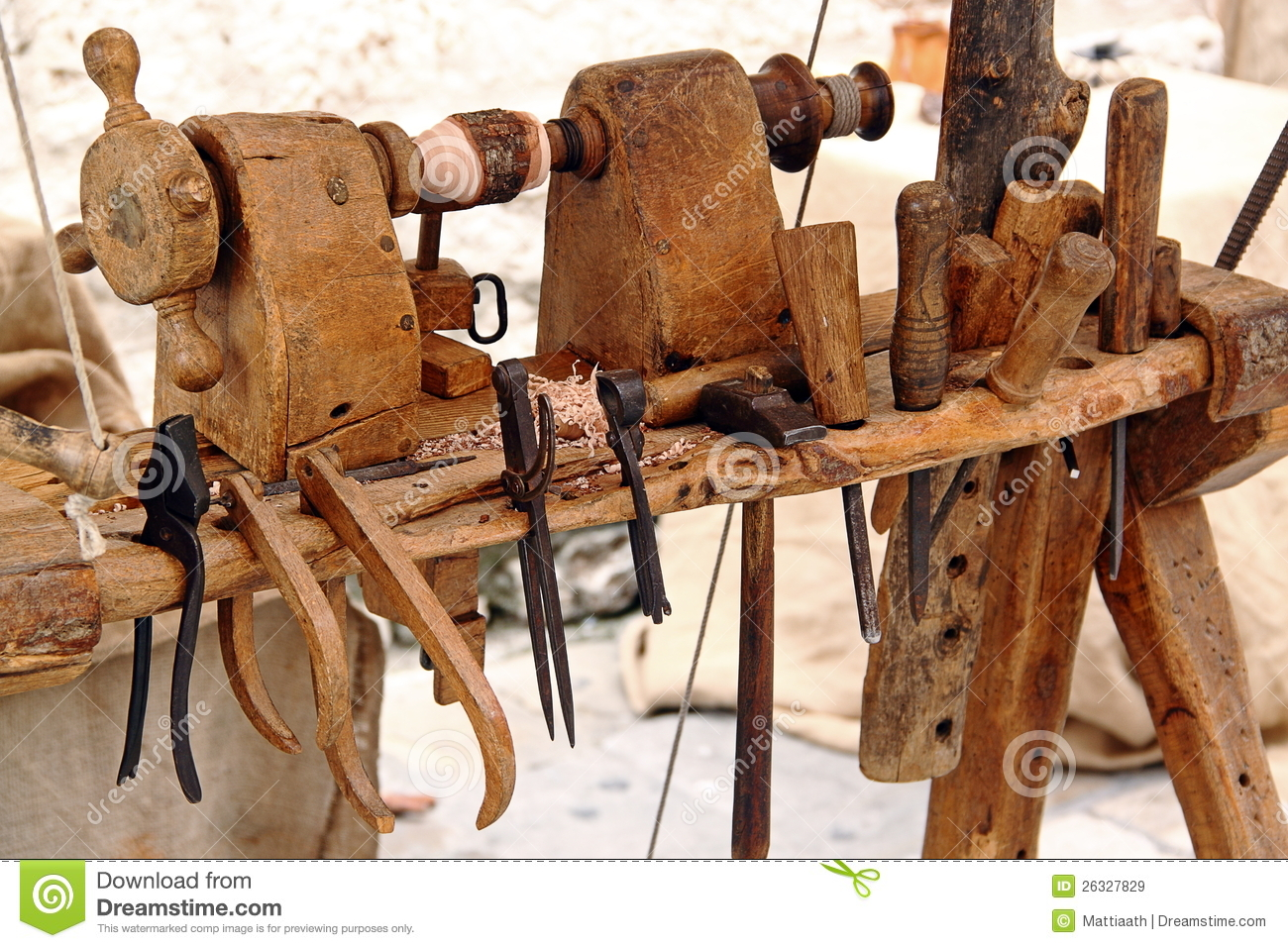 ... lathe with a set of tools for woodworking: hammer, chisels, pliers