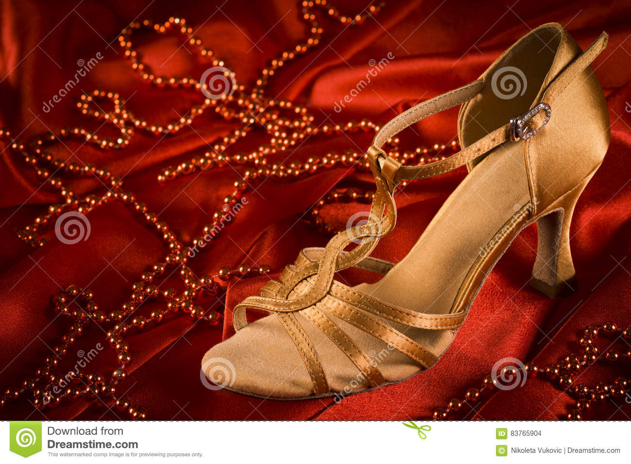 c53f2b817 Golden latin dance shoe is on red satin background with red pearls. More  similar stock images