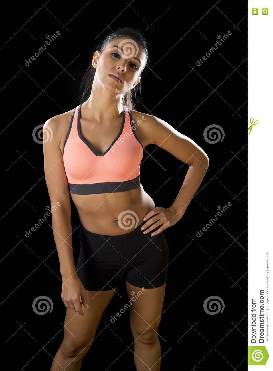 Latin sport woman posing in fierce and badass face expression with fit slim body