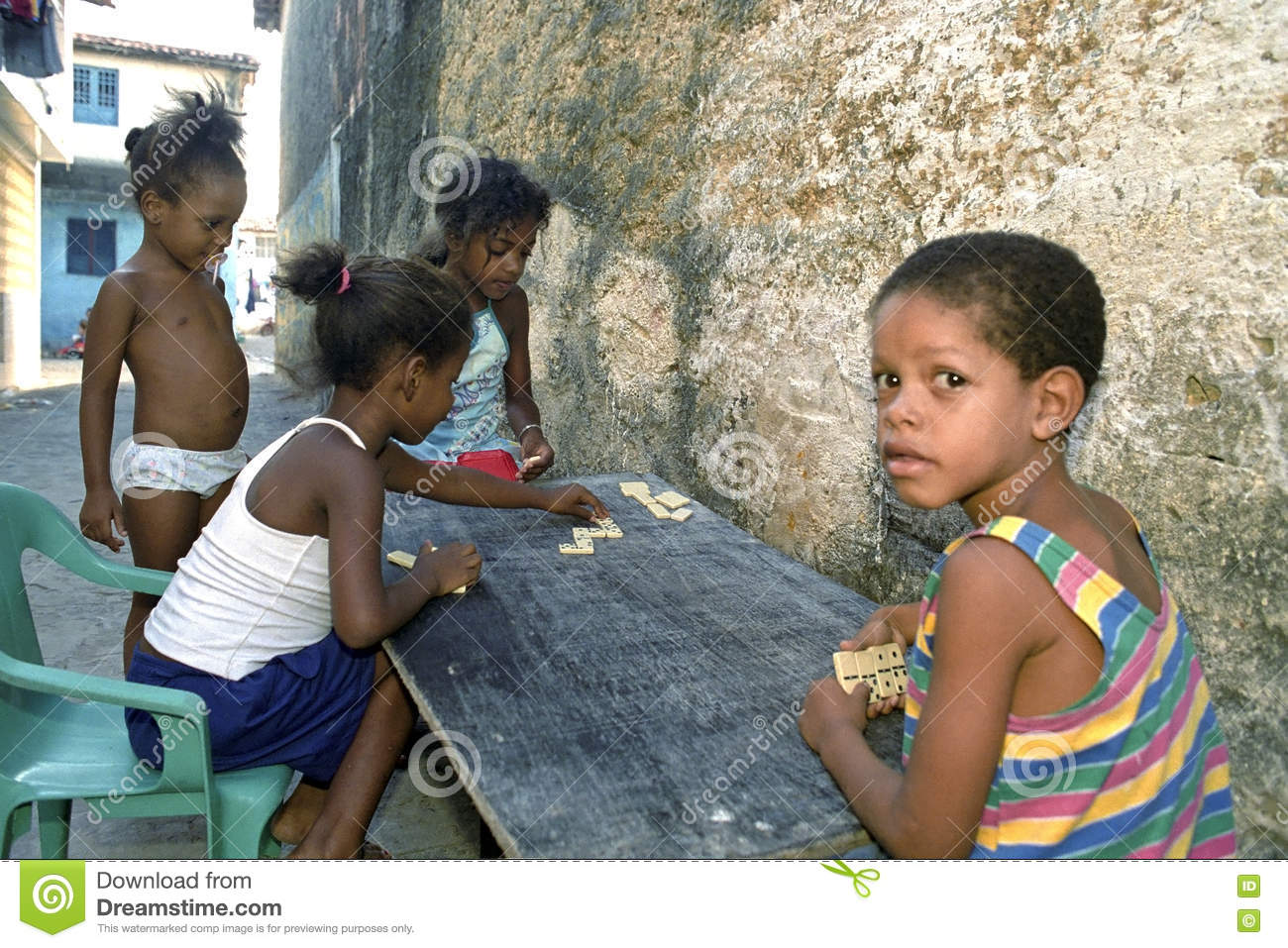 Latino children play Domino in slum, Recife, Brazil