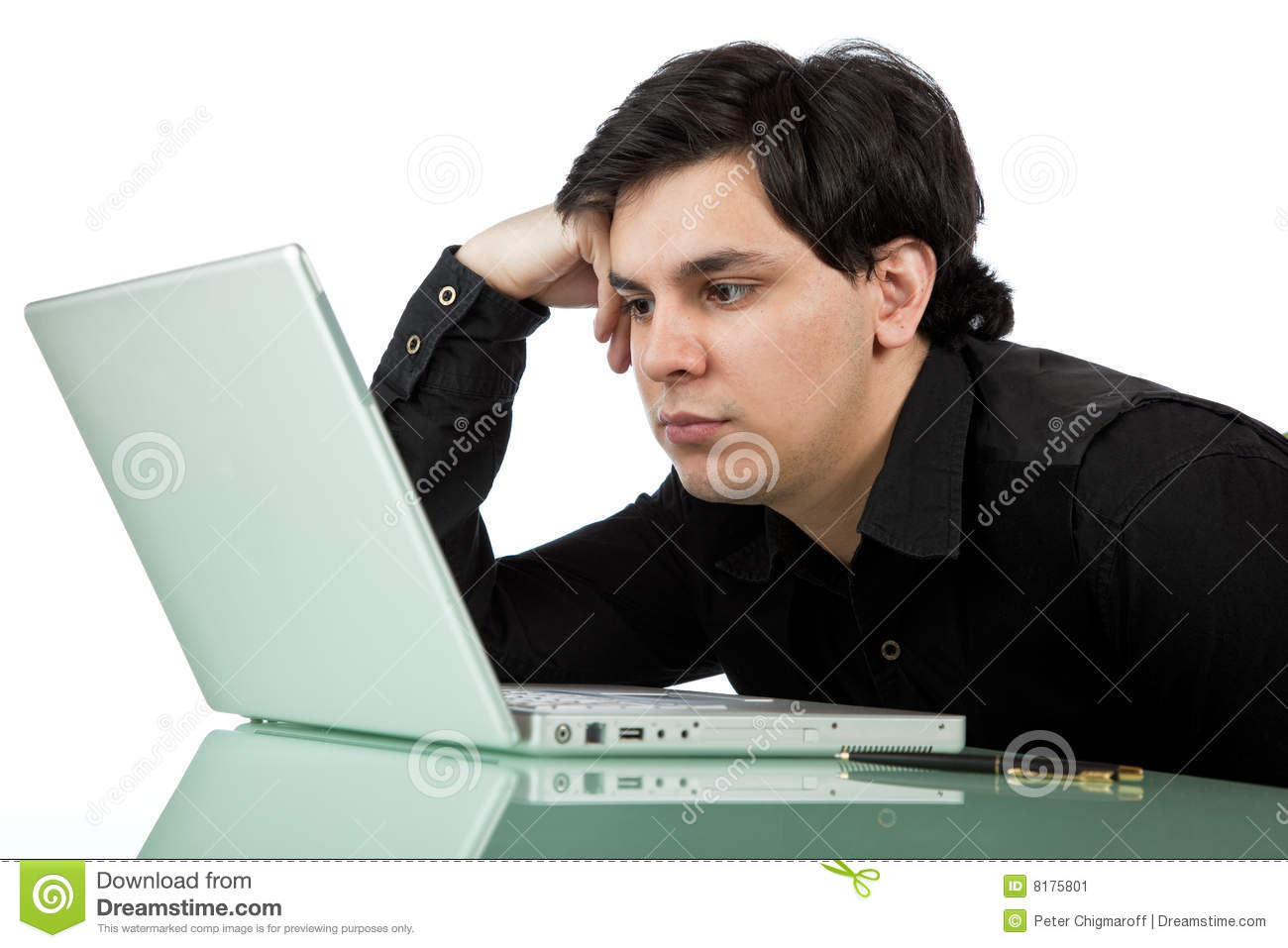 Stock image latino man working at a laptop computer