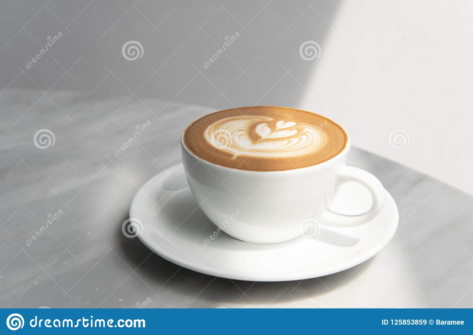 Latte or Cappuccino with frothy foam, coffee cup top view