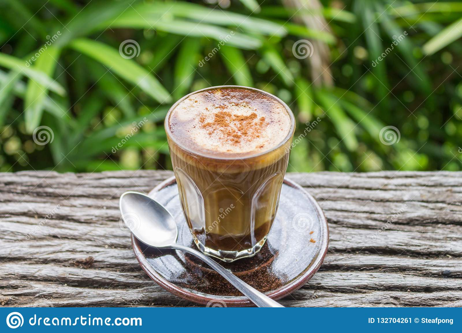 Astonishing Latte Coffee In Glass With Spoon On Wood Table On Natural Download Free Architecture Designs Scobabritishbridgeorg