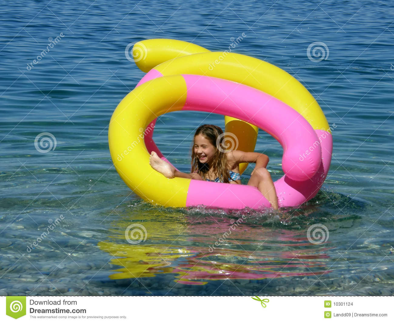 Beach Toys For Girls : Young teen girl on beach by lake summertime fun stock