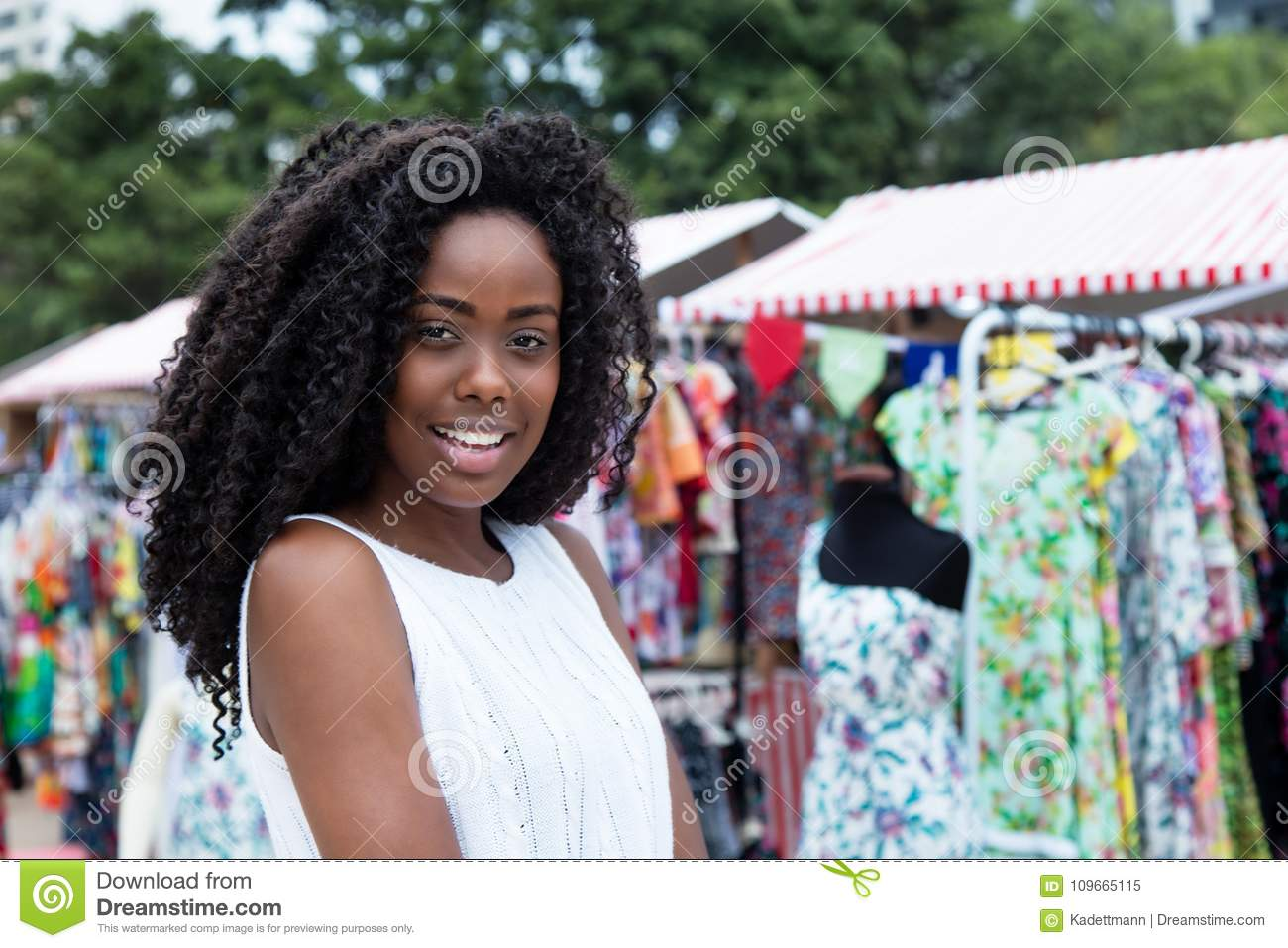 Download Laughing African American Woman Shopping At Market Stock Image - Image of nigerian, fashion: 109665115