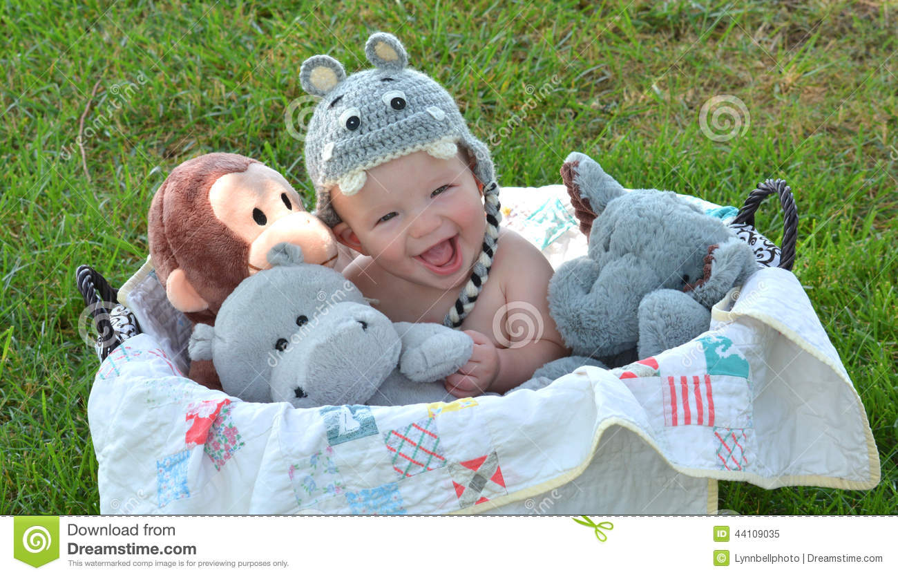 Laughing Baby Boy In Basket Of Stuffed Animals Stock Image Image