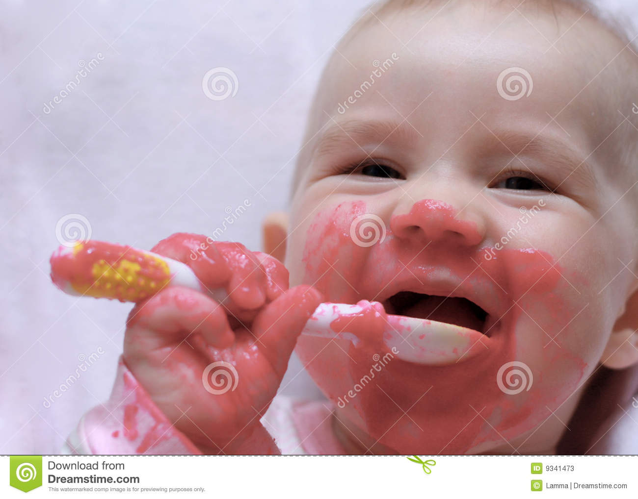 Laughing Baby With A Spoon In The Mouth Stock Photos ...