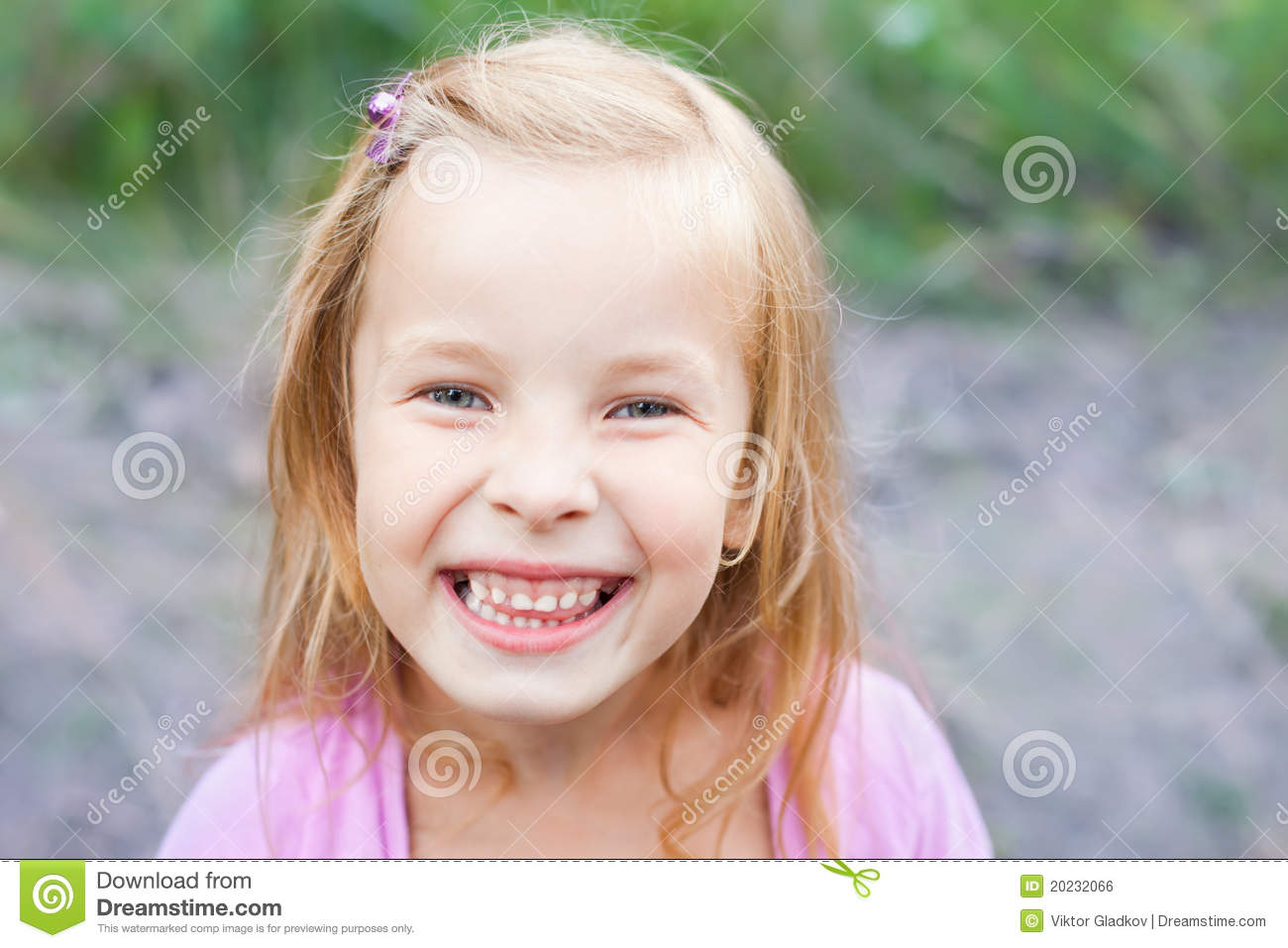 blonde little girl Laughing blonde little girl outdoors