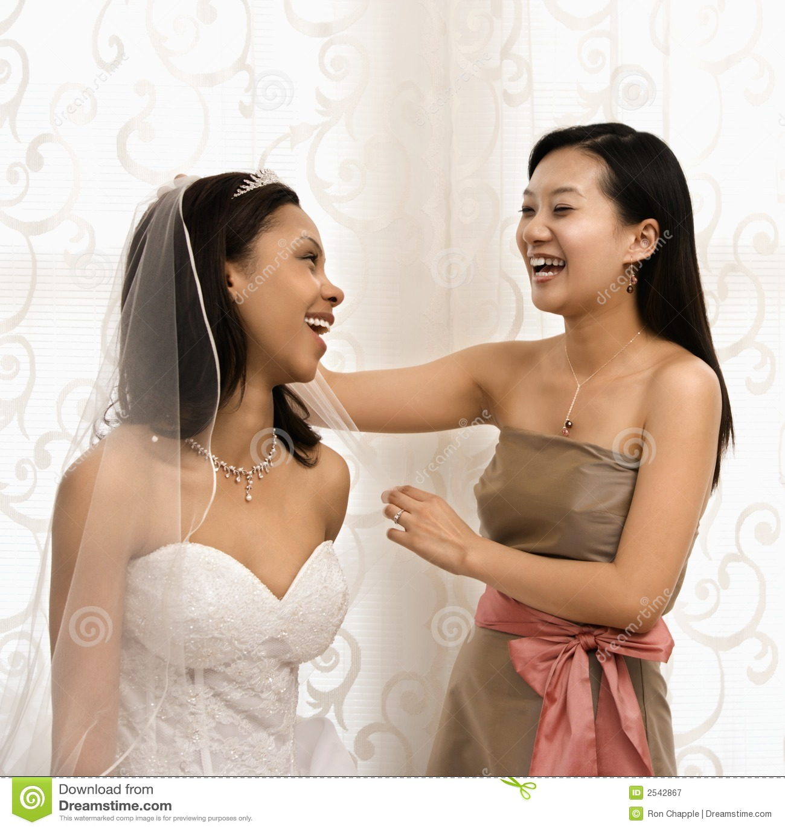 Laughing bride and bridesmaid.