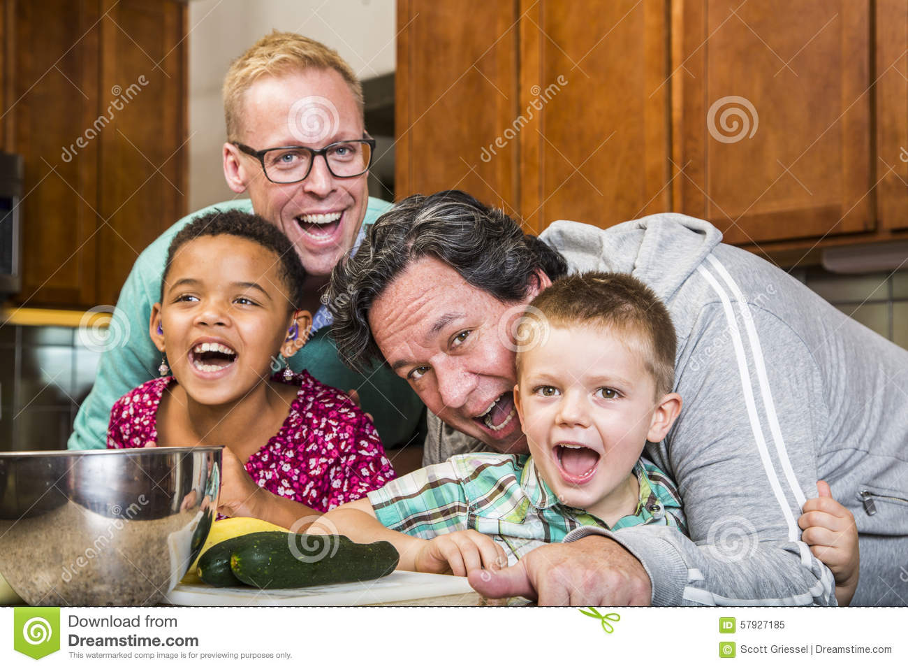 Laughing Family With Gay Dads In Kitchen Stock Photo - Image: 57927185