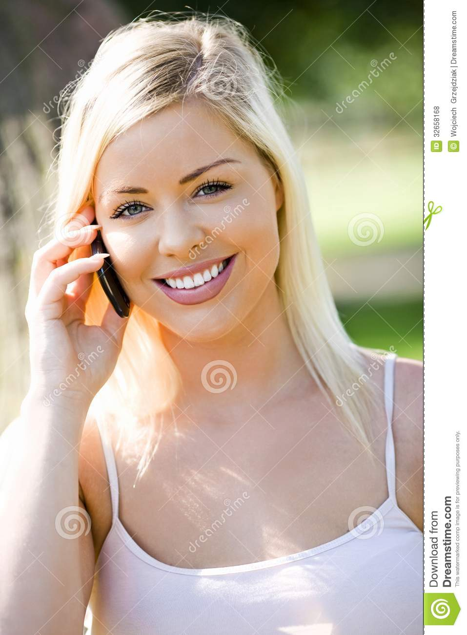 Laughing girl on smartphone royalty free stock photos image
