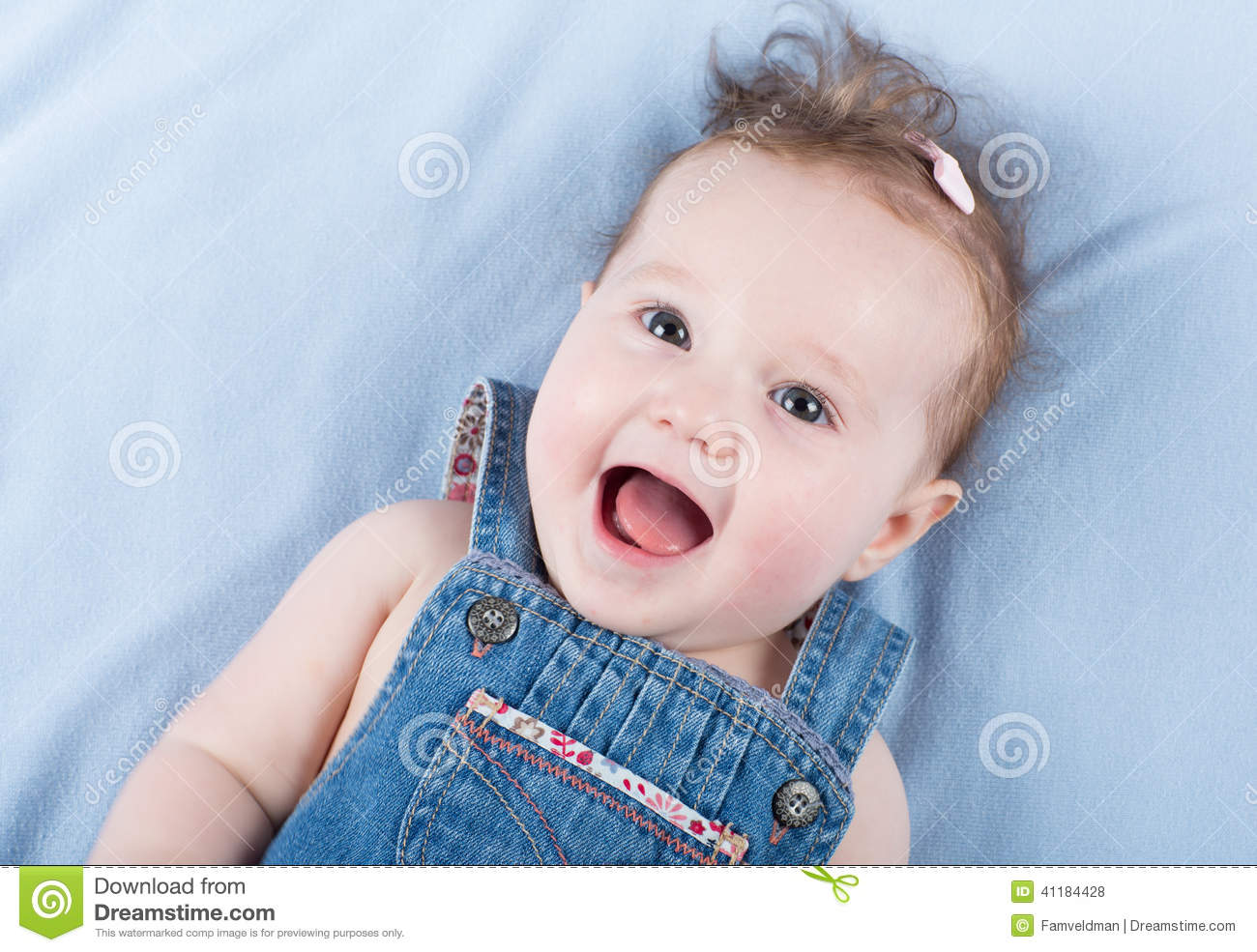 05e056ab0 Laughing Happy Baby Girl Wearing A Jeans Dress Stock Photo - Image ...