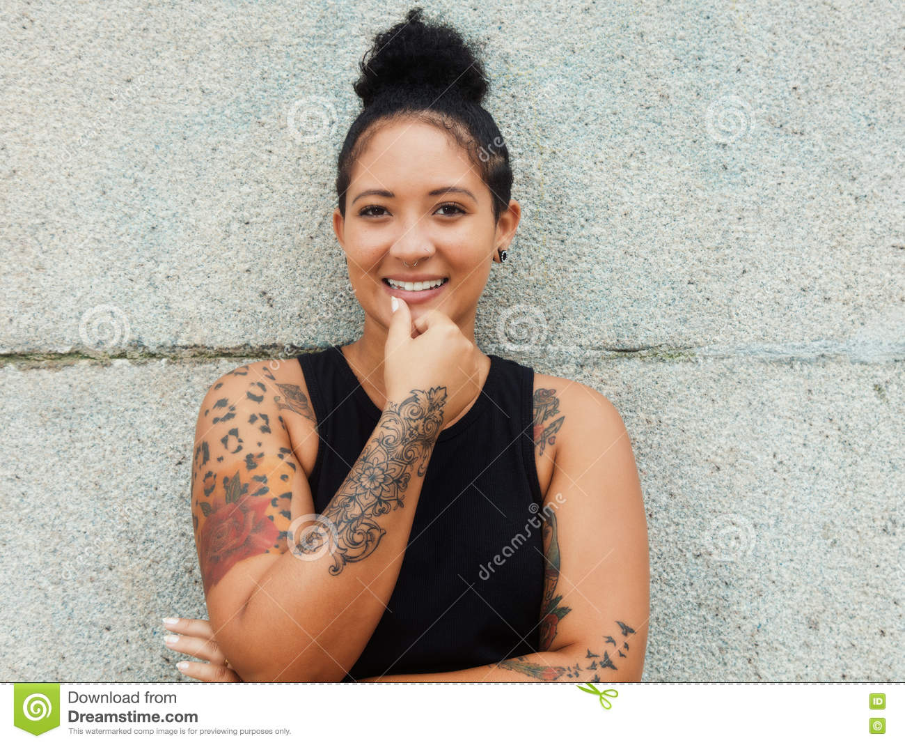 196beed2f Beautiful happy hipster girl with tattoos and piercing in urban style  outdoor in the summer