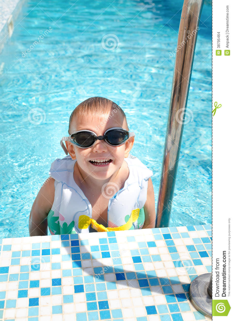 Laughing Little Boy Climbing Out Of A Pool Stock Image 38795461