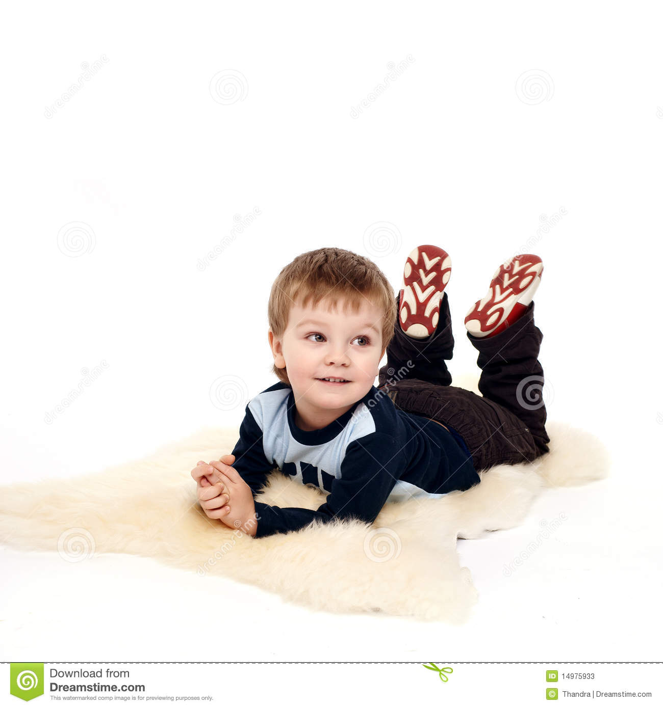 Little Boy Laying On The Floor Stock Image