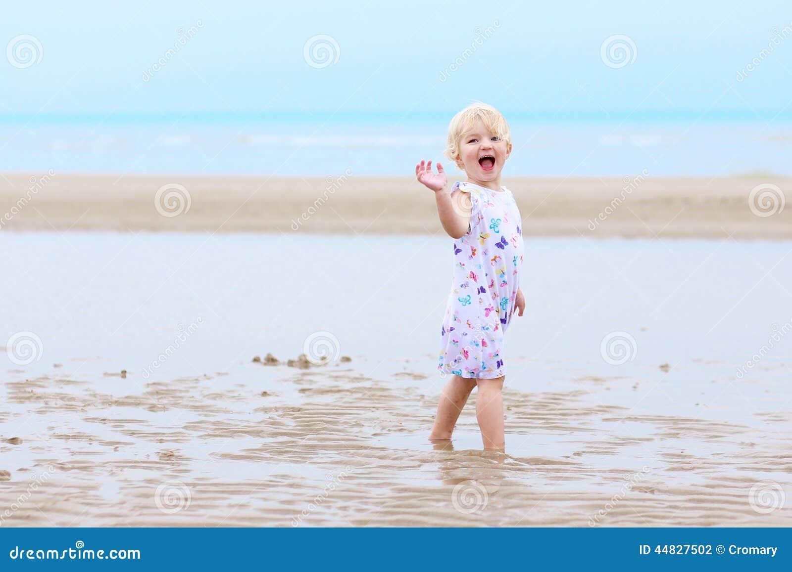 Little girl pussy on the beach