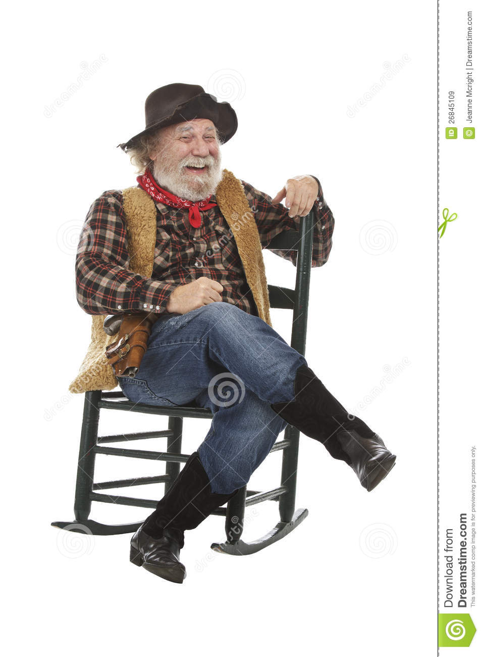 Laughing Old Cowboy Sits In Rocking Chair Royalty Free