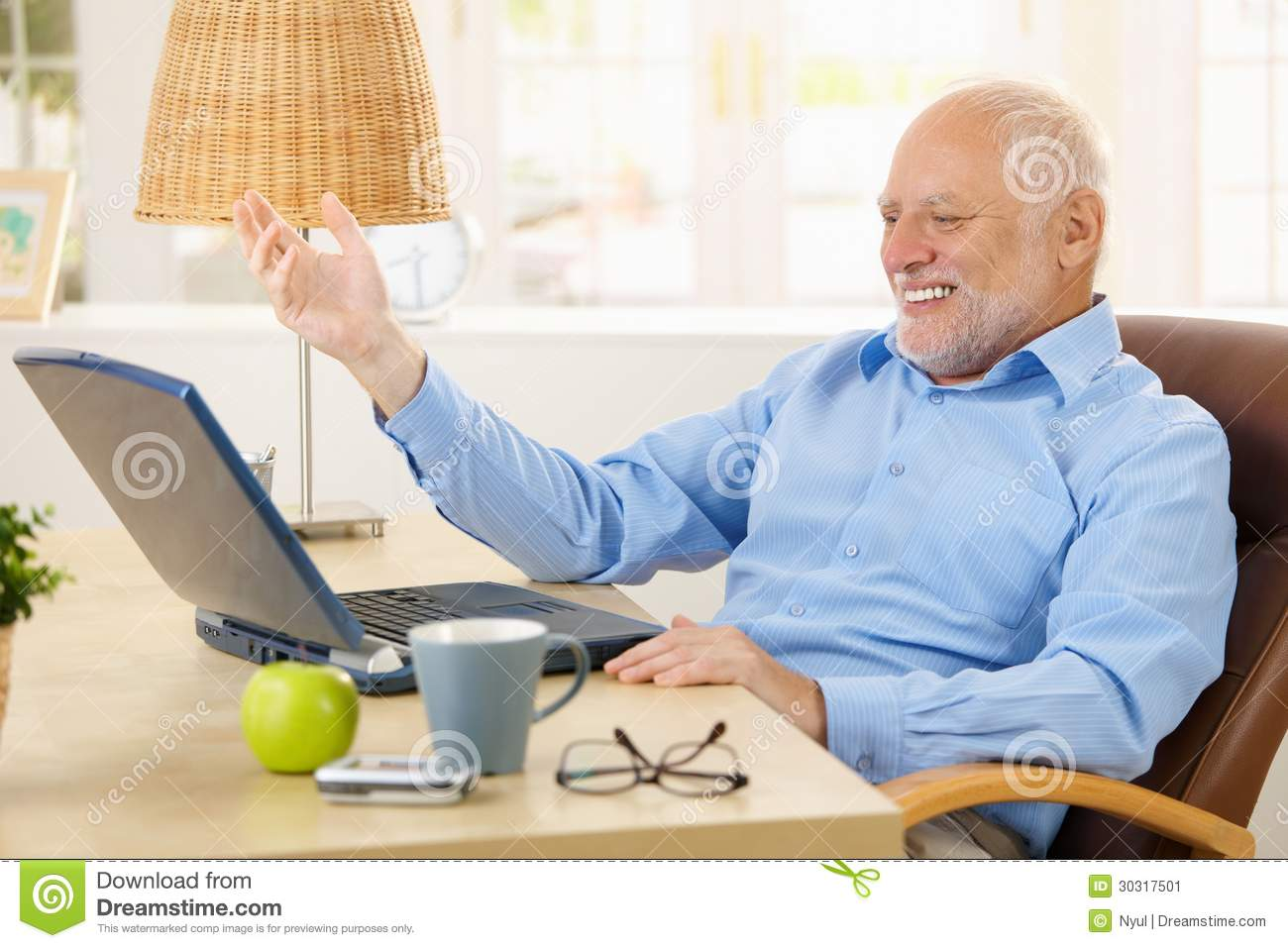 Laughing old man using laptop computer at home, looking at screen ...: www.dreamstime.com/stock-image-laughing-old-man-using-laptop...