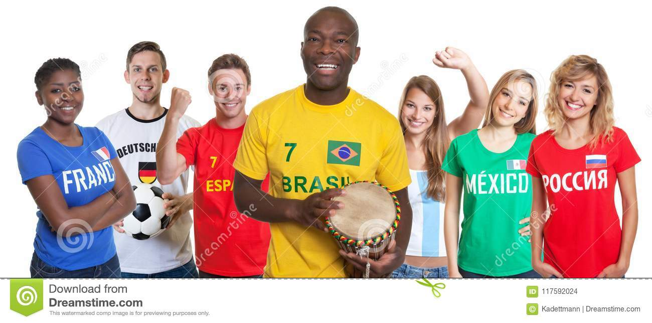 Laughing soccer supporter with drum and fans from other countries