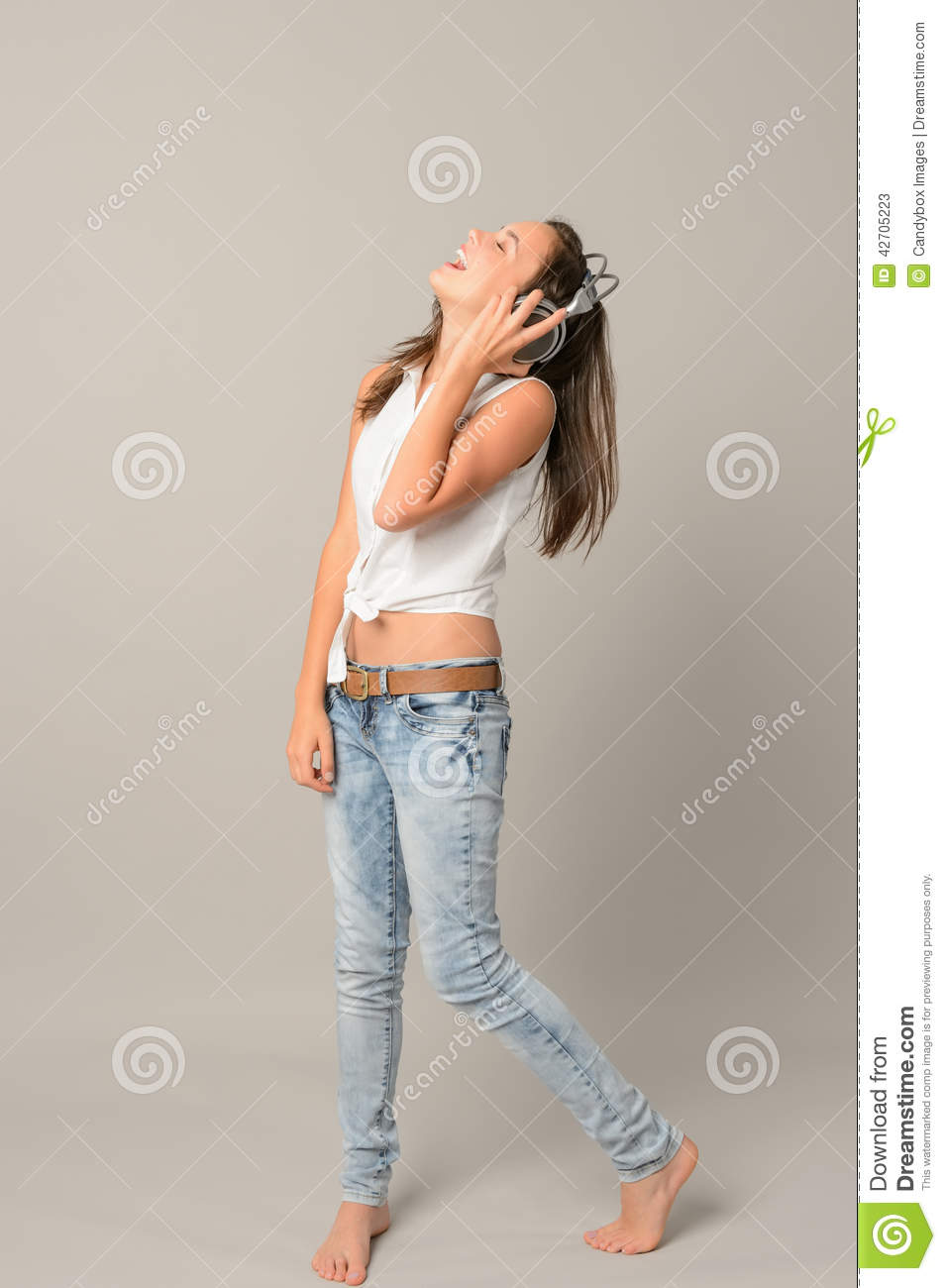 laughing girl with headphones stock image cartoondealer someone listening to music clipart boy listening to music clipart