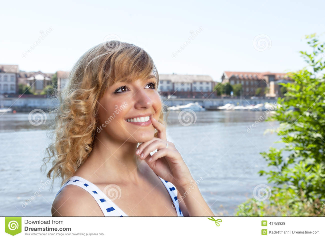 Thinking woman on a river