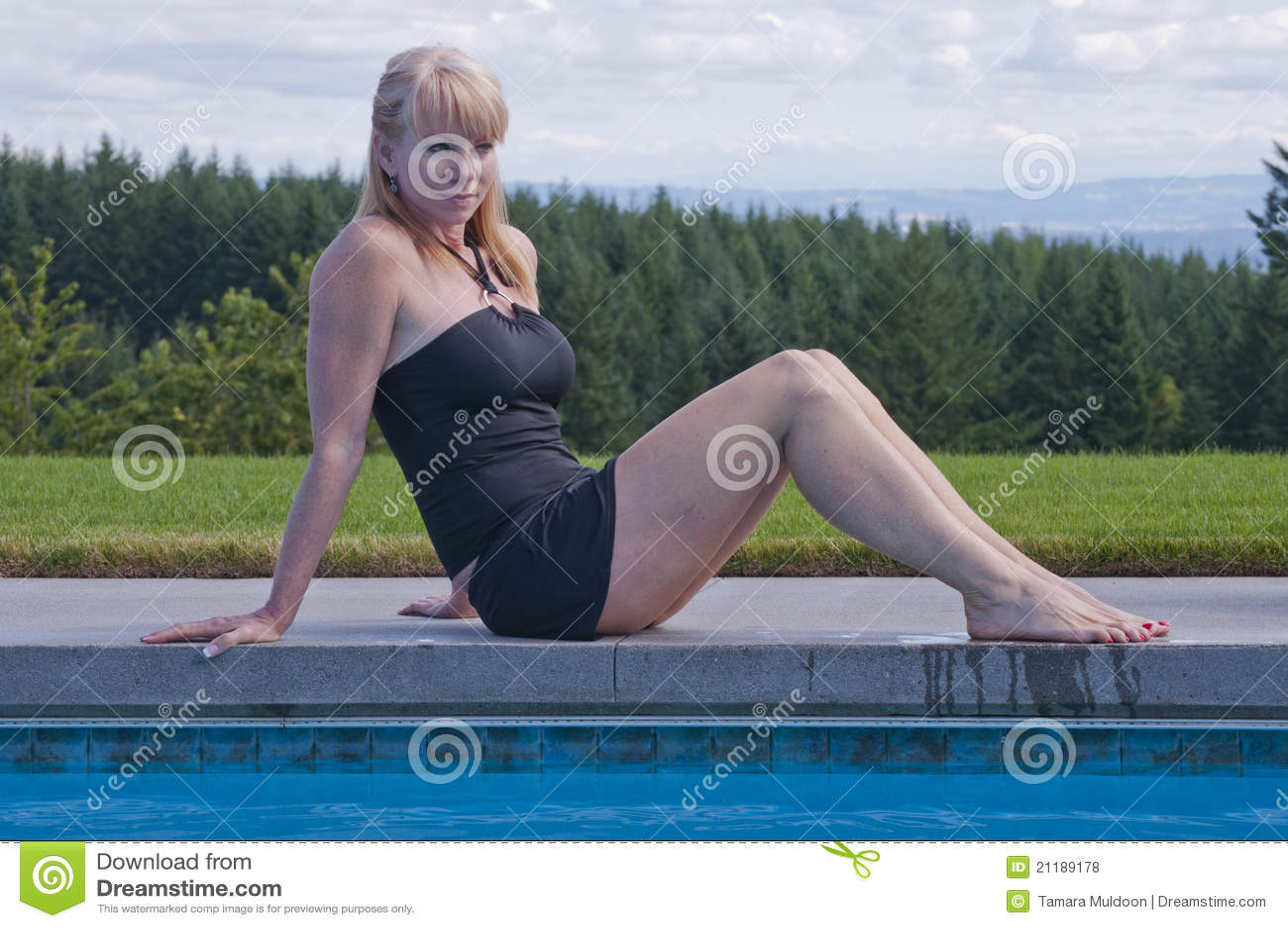 Laughing woman at swim pool