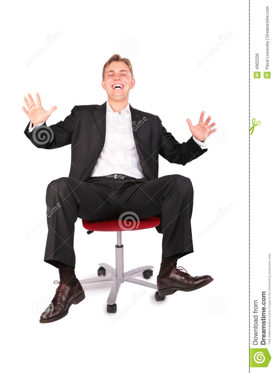 Laughing Young Person On Office Chair Royalty Free Stock