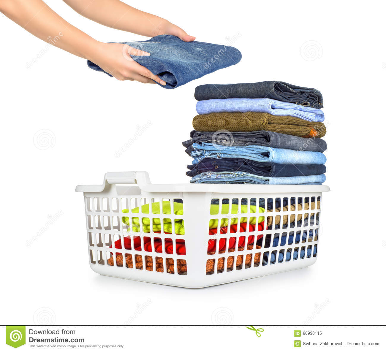 laundry basket with folded clothes stock photography