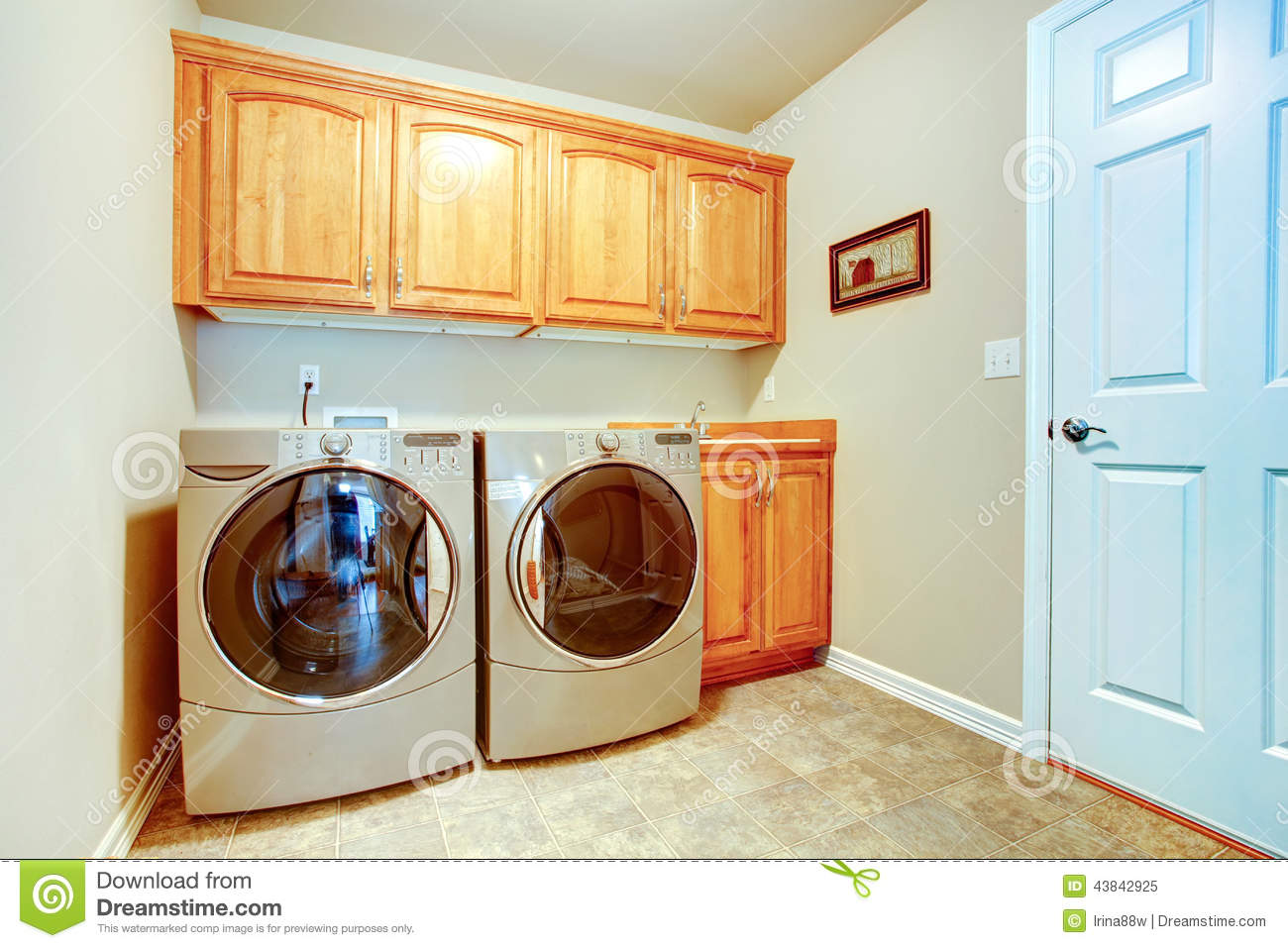 Laundry room with modern appliances