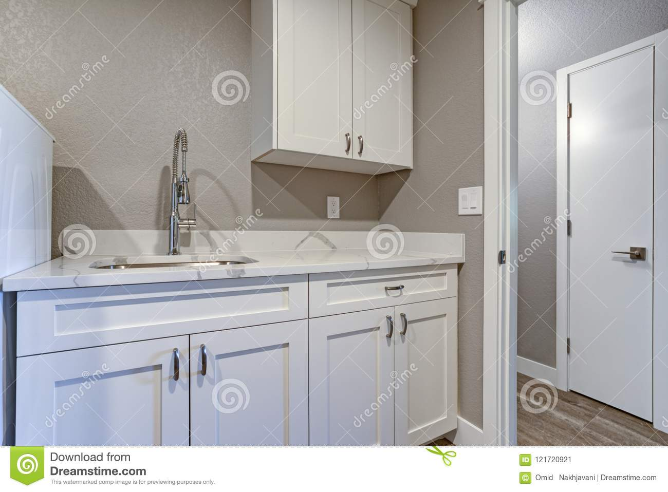 Fine Laundry Room With Taupe Walls And Marble Top Cabinets Stock Interior Design Ideas Gentotryabchikinfo