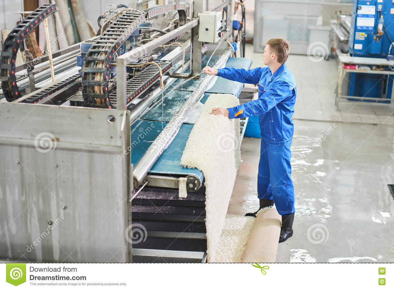 Laundry Worker In The Process Of Working On Automatic