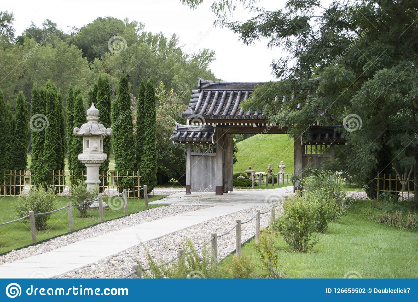 Formal Gardens On Display With Statuary, Interesting Outdoor Architecture  And A Sidewalk Lined With Stones.